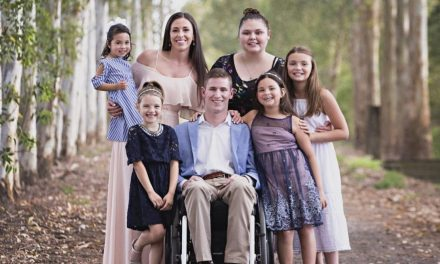 "Paralyzed Man Adopts 5 Foster Children, All Girls. They're ""Our Daughters Forever"""